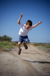 Happy Jumping Child by Chris Roll